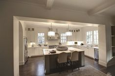 Suzie: Castro Design Studio - U shaped kitchen with floor to ceiling white shaker kitchen ...