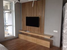 35 Wall Mounted TV ideas for your bedroom Salas Home Theater, Tv Wall Panel, Tv Wanddekor, Tv Feature Wall, Modern Tv Wall Units, Living Room Tv Unit Designs, Tv Wall Decor, Tv Wall Design, Tv Design