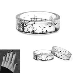 "Limited Time $19.95 Sale The Eerie Ring is a handmade ring that is completely transparent and features an ""eerie"" scene with a graveyard and bats laid into the"