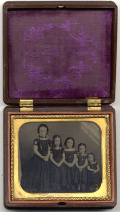 Graduated Girls  1/6 plate tintype of five  girls, perhaps sisters, standing in order from  tallest to shortest. All have necklaces
