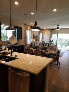Kitchen and living space in the Sarah model by Richmond American Homes in Cadence. Richmond American Homes, Living Spaces, Restaurant, Decorating, Kitchen, Model, Furniture, Home Decor, Decor