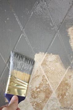 Paint tile backsplash with oil based paint for an easy update