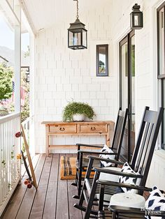 This picturesque porch was made for glasses of iced tea and shooting the breeze on summer evenings. Black rockers echo the home's dark trim and connote throwback comfort in a slightly more modern silhouette, amplified by ikat pillows in black and white.