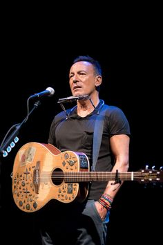 Bruce Springsteen is hilarious, heartbreaking, and political in his Broadway debut: EW review