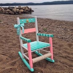 Custom hand painted childrens wooden rocking chair. The chair is 2 in height and 14 in width. It is painted with water based acrylic paint then