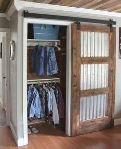Sliding barn doors are a practical option for small rooms, and this sliding barn door has corrugated steel panels in place of solid wood panels.