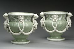 A pair of Minton cache pots in glazed parian with a celedon glaze after Chinese porcelain but modelled in the Sevres style