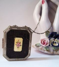 Vintage 1920s wristlet compact small and Lovely marked FHSCO/ Flapper Girl delight