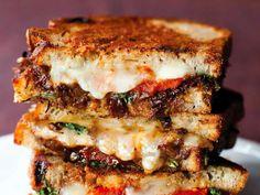 The Grilled Taleggio Sandwich With Dark Raisin Bread, Apricots, Capers, Arugula, and Fleur de Sel.