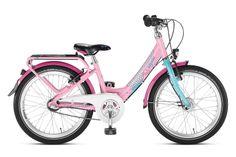 Różowo-turkusowy rower Puky Skyride 20-3 Alu Light posiada aluminiową ramę, 20 calowe koła, sztywny widelec, bardzo porządne błotniki, dynamo w piaście i stosowne oświetlenie, nóżkę, bagażnik, dwa hamulce v-brake, do zmiany 3 przełożeń przerzutki Shimano Nexus (w piaście z hamulcem) służy manetka obrotowa. Puky poleca rower Skyride 20-3 dla dzieci o wzroście od 120 cm / długość nóżki 55 cm / wiek 6+.