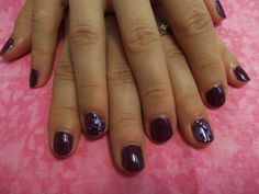 Shellac color with baby feet nail art.