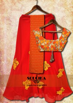 Orange and yellow thread work blouse with orange lehenga and dupatta, only from Soucika by Kamal Raj Manickath.  To order or inquire, Contact us at 080 41637631, 080 25505553, 080 41115006, or write to us at info@soucika.com.  #soucika  #kamalrajmanickath #ethnic #lehenga #blouse #orange and #yellow #femmefatale
