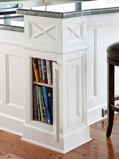 hidden cabinet in island leg for cook books