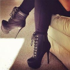High heel boots and black tights or pants