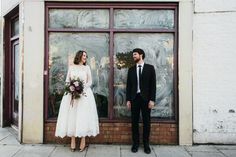 Bride & Groom City portrait - Image by Babb Photo - A London Autumnal wedding at the Londesborough pub in Stoke Newington with a bespoke wedding dress and photography by Babb Photo.