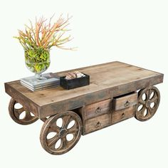 hand-crafted, plank-style table with wheels has the look of an old