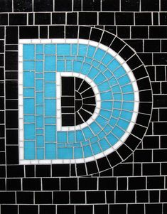 Mosaic Letter D- The Tieton Alphabet  Tieton Mosaic is a mosaic sign company in Tieton, WA specializing in typographic glass mosaic signage