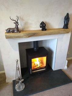 Expanded the fireplace opening, rendered and fitted riven slate hearth. Parkray Aspect 5 woodburner fitted along with oak beam.