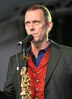 Hugh Laurie.Cornbury Music Festival, near Oxford, England..June 30th 2012.on stage in concert live gig performance performing half length black suit jacket red waistcoat singing .CAP/JILL.©Jill Mayhew/Capital Pictures.