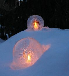Fill a round balloon with water and set outside until almost frozen through. Run hot water over frozen globe until balloon pops off. Pour out unfrozen water from inside and insert a tealite. Makes a great walkway accent.