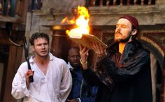 """From the Globe's production of """"Dr. Faustus.""""  Books on fire. Because eff it, we're setting the book on fire."""