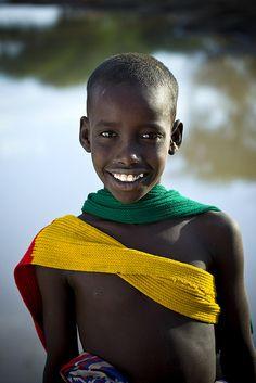 Afambo boy smiling, Danakil, Ethiopia by Eric Lafforgue, via Flickr