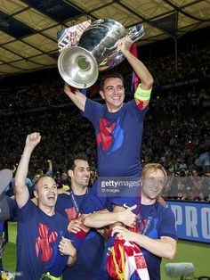 Andres Iniesta of FC Barcelona, Sergio Busquets of FC Barcelona, Xavi Hernandez of FC Barcelona, Ivan Rakitic of FC Barcelona with Champions League trophy during the UEFA Champions League final match between Barcelona and Juventus on June 6, 2015 at the Olympic stadium in Berlin, Germany.