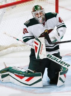 Minnesota Wild goalie Devan Dubnyk makes a save against the Colorado Avalanche during the third period of an NHL hockey game Thursday, Oct. 8, 2015, in Denver. Minnesota beat Colorado 5-4. (AP Photo/Jack Dempsey)