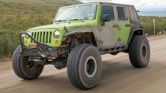 Model: 2012 Jeep Wrangler Unlimited Engine: 3.6L Transmission: WA580 Transfer case: Atlas II, 4.3:1 low range Front axle: Dynatrac ProRock 60, ARB Air Locker, 5.38 gears Rear axle: Dynatrac Trail Series 60, ARB Air Locker, 5.38 gears Suspension: EVO Mfg. Double Throwdown, EVO Lever rear, EVO high-clearance long arm, Currie Antirock rear Tires: 40x13.50R17 Nitto Trail Grappler Wheels: 17x9 ATX Slab beadlock Armor: EVO Mfg. front bumper, sliders, and tire carrier