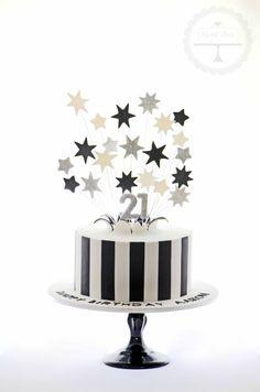 Monochrome exploding stars birthday cake