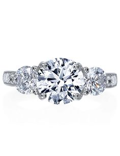 """""""Yolanda"""" - Win her love with this platinum engagement ring featuring a round center stone encased by two round side stones with 1.20ct G-VS diamonds down the shank with. Customize this ring with any size center stone."""