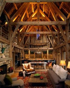 Cabin interior with  wooden beams and a high ceiling living room