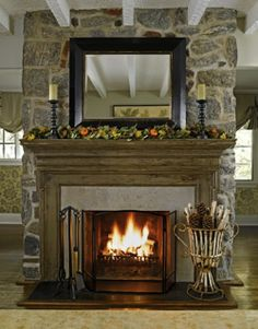 Love this central fireplace and beamed ceiling. I wonder if the fireplace is open on the back too?