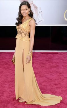 Naomie Harris in a gorgeous caramel and golden gown made from recycled materials by Ghana-born designer Michael Badger, who was mentored by Vivienne Westwood....Oscars 2013