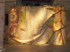 "El Anatsui ::Amazing large scale pieces made by African artist, El Anatsui, out of recycled foils from liquor bottles pieced together by little wires. There is one called ""old man's cloth"" at the Harn Museum that remains my favorite at that museum."