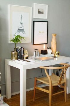 light grey walls + gorgeous natural chair + parsons desk + gold accents + Eiffel tower art + candles =  domestic bliss