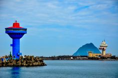 Keelung Port entrance. The blue tower is an abandoned restaurant. On the opposite side the Control tower and Keelung island