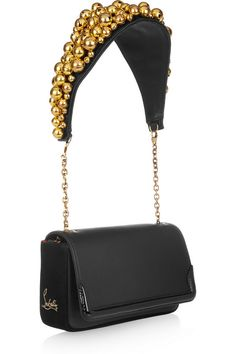 This is the first Louboutin purse I don't hate. It's lovely.