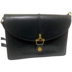 80's Vintage Gucci navy leather  shoulder bag with golden horsebit motif closure | From a collection of rare vintage shoulder bags at https://www.1stdibs.com/fashion/handbags-purses-bags/shoulder-bags/