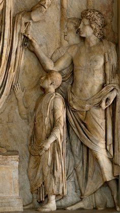 Donation of food to Roman children (close-up). Relief panel from the so-called the Arch of Portugal on via Lata. Marble. 2-nd cent. A.D. 293 cm. Inv. MC 0832. Rome, Capitoline Museums.