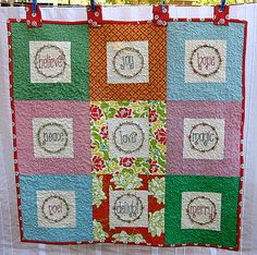 LOVE the embroidery in this Christmas quilt.  I'd want to do with more obviously Christmas prints though.