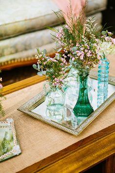 vintage glass tray with mismatched glass bottles on them. So gorgeous. http://www.weddingchicks.com/2013/09/30/vintage-vineyard-wedding/