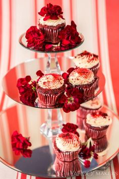 When you've made a beautiful batch of cupcakes , you want a beautiful way to display them . An elegant, mirrored tower fits the bill and is oh-so-easy to DIY! When you pick up a few glass or lucite candlesticks and some mirrored rounds, you're just a little hot-gluing away from a decadent dessert display. Another bonus?