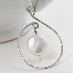 White Coin Pearl Necklace - Hand formed Spiral Wire Wrapped Bridal Jewelry Sterling Silver. $45.00, via Etsy.