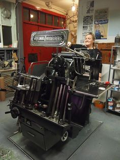"""Olöf introduces me to the """"mastermind"""" behind the printing operations, a large, traditional Heidelberg German printing machine!"""