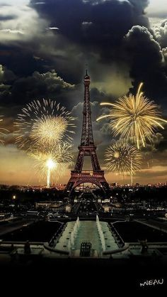 Fireworks over the Eiffel Tower. ...