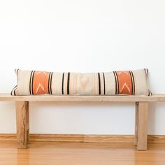 The Catarina Lumbar Pillow - This pillow is your one-stop shop find that will add a pop of color and fun pattern to an all-white bed or neutral couch. Handwoven by women artisans in Southern Mexico, the pattern of the Catarina Lumbar Pillow is inspired by their native tribe but designed to complement the modern home.