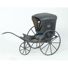 Victorian Buggy Form Baby Carriage, traditional mid-Victorian covered buggy with folding oil cloth top, having oval glass windows in sides and rear, painted and striped wood frame and wheels with original single front wheel and curved wood handle; interior in original tattered cloth with straw stuffing; old painted label on side of oil cloth in white reads 100 Years Old; 26 wide x 36 high x 58 long.