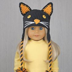 """BLACK CAT HALLOWEEN COSTUME HAT for AMERICAN GIRL DOLLS ❤ Crochet pattern in the book """"Amigurumi Holiday Hats for 18-Inch Dolls"""" by Linda Wright. Book available at Amazon.com. A super cute Halloween hat for American Girl dolls."""