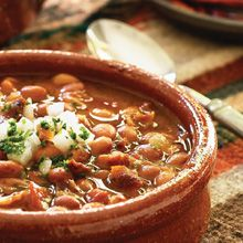 ... pinto beans, simmered in a flavorful tomato sauce with bacon and chile